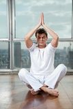 Young Man Practicing Yoga At Gym Stock Photo