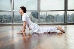 Young Man Practicing Yoga At Gym Royalty Free Stock Image