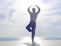 Young man practicing yoga Stock Photography