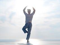 Young man practicing yoga Royalty Free Stock Photos