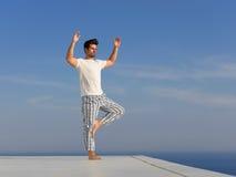 Young man practicing yoga Stock Photo