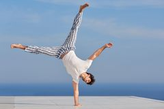 Young man practicing yoga Royalty Free Stock Images