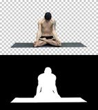 Young man practicing yoga in lotus position, Alpha Channel stock photography