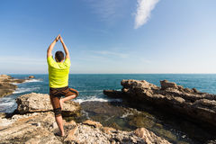 Young man practicing yoga. Royalty Free Stock Image