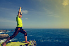 Young man practicing yoga and meditating. Stock Photography