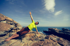 Young man practicing yoga and meditating. Stock Photos