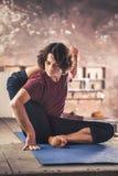 Young man practicing yoga meditation Stock Photos