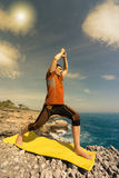 Young man practicing yoga and meditation. Stock Images