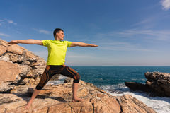 Young man practicing yoga and meditation. Stock Image