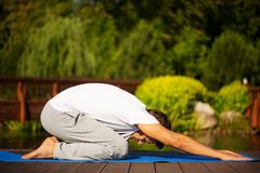 Young man practising yoga Stock Images