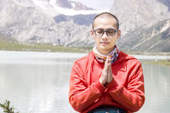 Young man pray in nature Stock Photography
