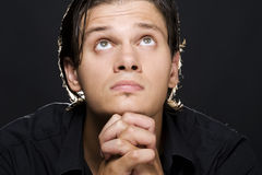 Young man praying Royalty Free Stock Image
