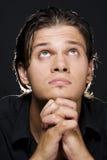 Young man praying. Closeup portrait of a young man praying to god Stock Photos