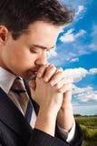 Young man praying Stock Photography