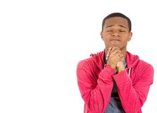 Young man praying, asking for forgiveness Royalty Free Stock Image