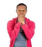 Young man praying, asking for forgiveness Stock Images