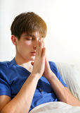 Young Man praying Stock Photo