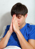 Young Man praying Stock Photography