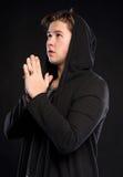 Young man praying Royalty Free Stock Photos