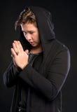 Young man praying Royalty Free Stock Image