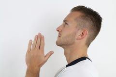 Young man praying Stock Photos