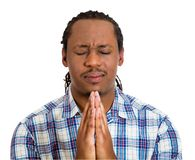 Young man praying hands clasped, hoping Stock Photos