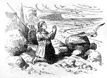 A young man praying. Kiev, Ukraine - March 24, 2018: ILLUSTRATIVE EDITORIAL The reproduction of antique engraving that shows a young man praying on the beach Stock Photo