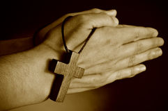 Young man praying, sepia toning Stock Images
