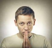 Young man praying or thinking Royalty Free Stock Photo