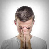 Young man praying or thinking Royalty Free Stock Images