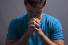 Young Man Prays Stock Images