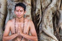 Young man prays Stock Photo