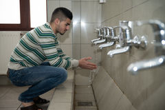 Young Man Prepairing To Take Ablution Stock Images