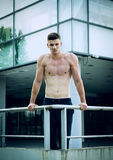 Young man prepares for hard training in front of sport center. royalty free stock images