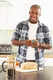 Young Man Preparing Breakfast In Kitchen Stock Photography