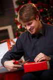 Young man preparing for christmas eve Royalty Free Stock Photography