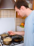 Young man preparing food Royalty Free Stock Photos