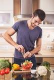 Young man preparing food at home Royalty Free Stock Image