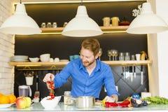 Young man preparing healthy food Royalty Free Stock Image