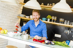 Young man preparing healthy food Royalty Free Stock Images