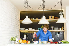 Young man preparing healthy food Stock Images