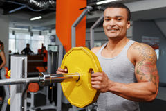 Young man preparing his barbell Royalty Free Stock Photos