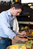 Young man preparing lunch Royalty Free Stock Photos