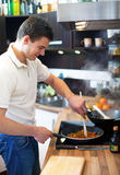 Young man preparing lunch Royalty Free Stock Image