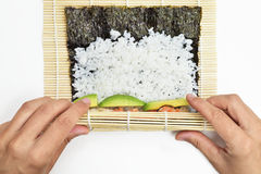 Young man preparing makizushi Stock Photo