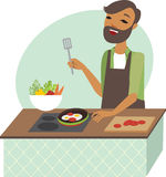 Young man preparing meal Stock Photo