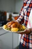 Young man preparing a roast turkey Stock Photos