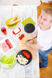 Young man preparing a Sandwich Stock Photography