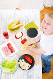 Young man preparing a Sandwich Royalty Free Stock Image