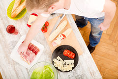 Young man preparing a Sandwich Royalty Free Stock Images